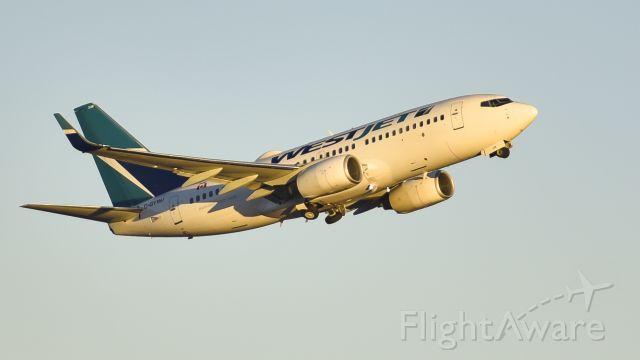 Boeing 737-700 (C-GYWJ) - blasting out at dawn
