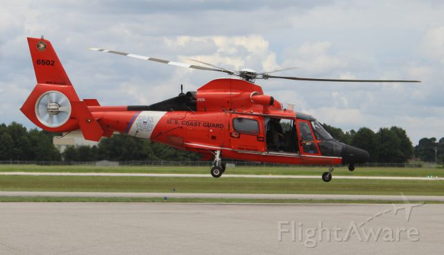 USCG6502 — - A U.S. Coast Guard Aerospatiale MH-65D Dolphin (Dauphine) lifting from the Gulf Air Center ramp following a ground taxi at Jack Edwards National Airport, Gulf Shores, AL - June 28, 2017.