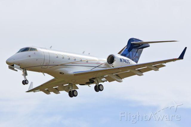 Bombardier Challenger 300 (N74ZC) - Challenger 300 landing Rwy 31. 9-20-13