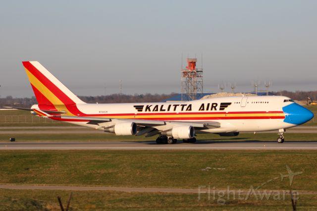 Boeing 747-400 (N744CK) - Kalitta 747-400 wearing the mask livery departing RWY 18L.