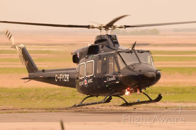 Bell 412 (C-FYZR) - RCAF Bell 412 just lifting off from YQV