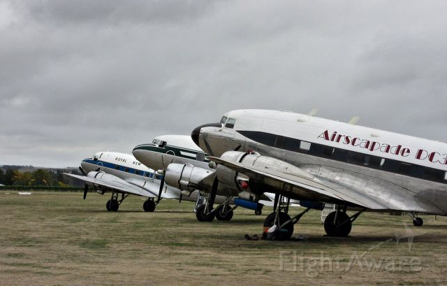 Douglas DC-3 (ZK-JGB) - 3x flying examples on the ground, Classic Fighters 2015.br /From  NZ Civil Aircraft Blog:br /Starting in the US Military as Bu4703, then down to Colombia. Back to the States as N1699M followed by a time as N69D before returning to N1699M. br /N234Z was its next registration followed by HZ-TA3 - then back to N234Z. br /South Africa was next as ZS-MRU, then Iceland and TF-AVN and in 2011 it became N451ZS.