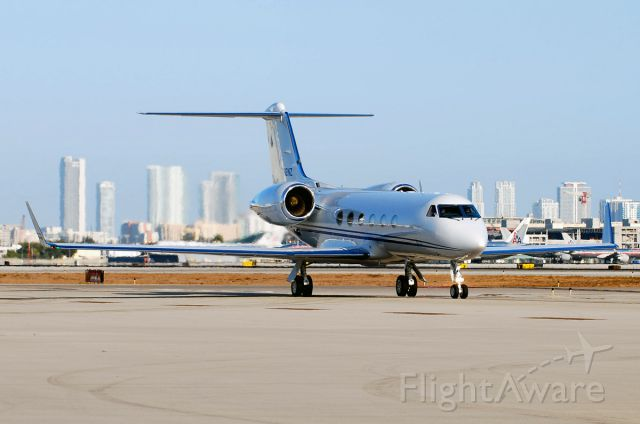 Gulfstream Aerospace Gulfstream IV (N12NZ) - Taxiing with downtown Miami as the backdrop