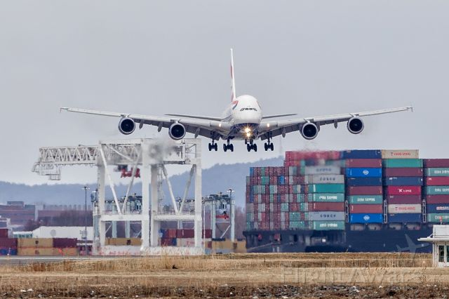 Airbus A380-800 (G-XLEE) - First scheduled BA A380 flight to Boston. Landing between a cargo vessel and an AT-AT.