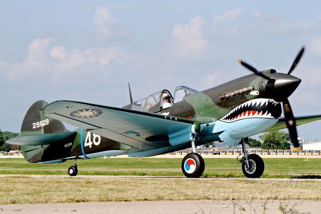 N1226N — - A Curtiss Kittyhawk IV (Warhawk) taxies out to take part in the Tora Tora Tora enactment at Airventure 2012