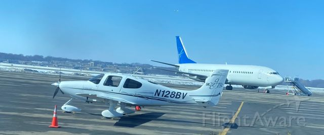Cirrus SR-22 (N128BV) - At Wisconsin Aviation on private aircraft side of Truax Field. No id on Boeing 737-couldn't make out registration. Charter?