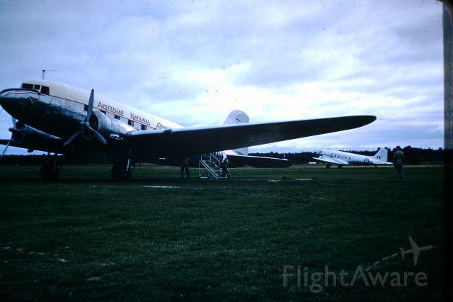 Douglas DC-3 (VH-ABR) - ANA DC3 VH-ABR at Flinders Island, RAAF C47 behind, circa 1958