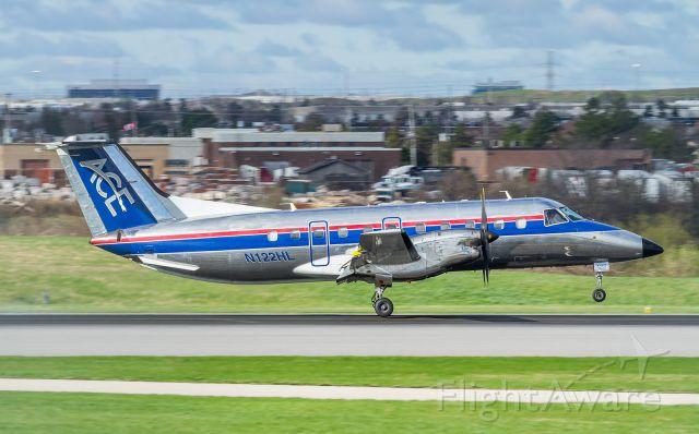 Embraer EMB-120 Brasilia (N122HL) - FRG9122 (Freight Runners Express) lands on runway 33L arriving from General Mitchell Intl (KMKE)