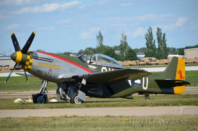 — — - EAA 2011 P-51D Gunfighter just hanging out doing what P-51s do without effort - looking good!