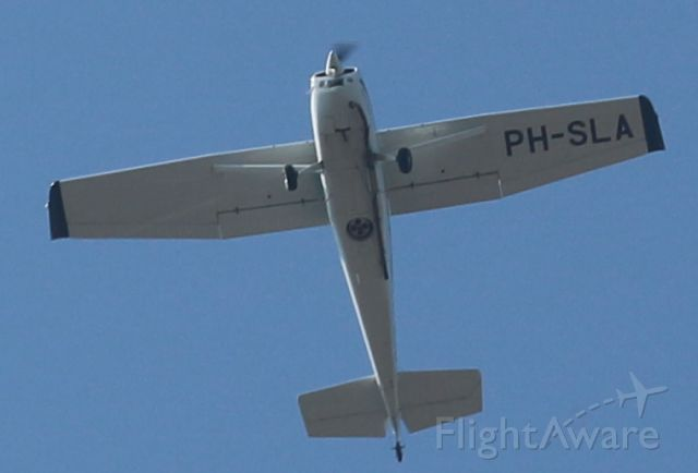 Cessna Skywagon 180 (PH-SLA) - Carthographic plane low pass flyover. They do digital camera flights. Nice to see the camera mid bottom and the longer exhaust pipe so it won't effect picture quality. They looked down, and I was looking up. ;-)