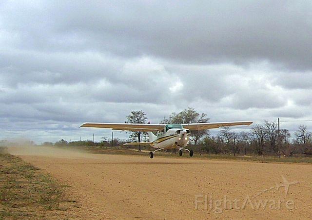 Cessna Centurion (ZS-AVB) - Take off at Ingwelala, South Africa