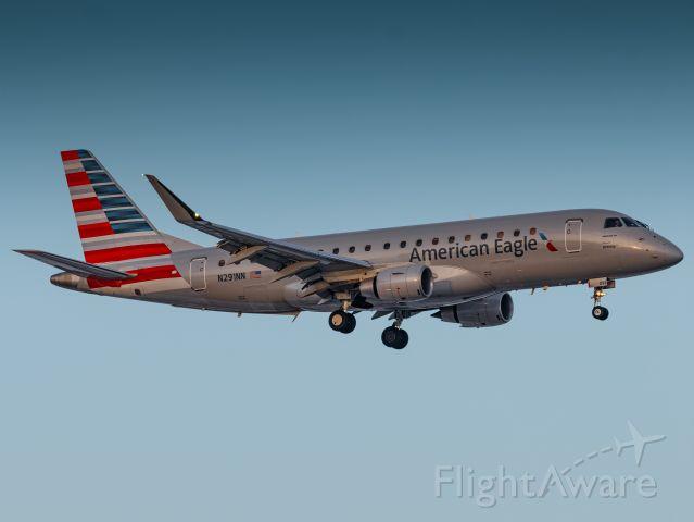 Embraer 175 (N291NN) - Short final in calm winds, right at sunset, making for a beautiful landing on Eppley Airfield's runway 14R on New Year's Day!