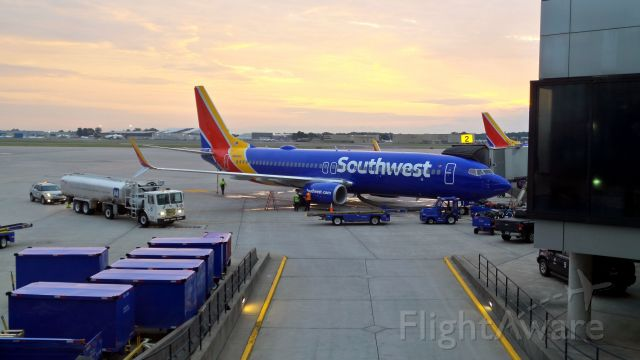 Boeing 737-800 (N8686A) - Early morning Southwest flights getting ready at Bradley Airfield