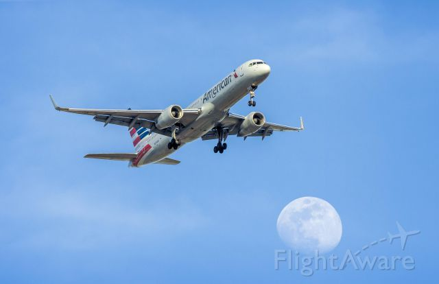 Boeing 757-200 (N203UW) - From my hotel I noticed that the aircraft landing at Sky Harbor were flying a path across the evening moon, all I had to do is wait for the right moment and the moon to rise a little bit more. Ya I could have photo shopped one in faster, but I didn
