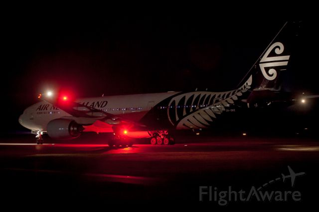 BOEING 777-300 (ZK-OKE) - The red strobes of B773 ZKOKE overpower the night and the camera as she taxies down Taxiway Alpha for Runway 02 at Christchurch Airport. She was returning back up to Auckland after having diverted a few hours earlier down to NZCH from Auckland due to bad weather. She had come over from Brisbane Australia on 6 Jul 2017, and along with 4 other B777s and 2 A330s had all diverted down to us as Auckland had a bad weather bomb passing over the airfield with many lightning strikes at their arrival times. The weather prevented most landings and any refuelling. So, for us at NZCH, we had a wonderful freezing cold evening down at the fence shooting rarities to this neck of the ANZ woods.