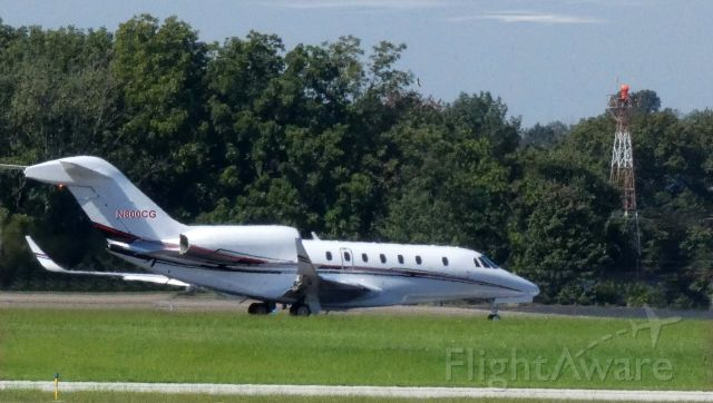 Cessna Citation X (N800CG) - On the departing paved runway is this Cessna Citation 750 in the Summer of 2021.
