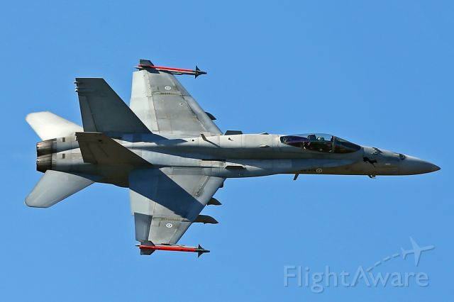 — — - Finnish AF Hornet running in from the left during its display at RIAT, Fairford, UK.