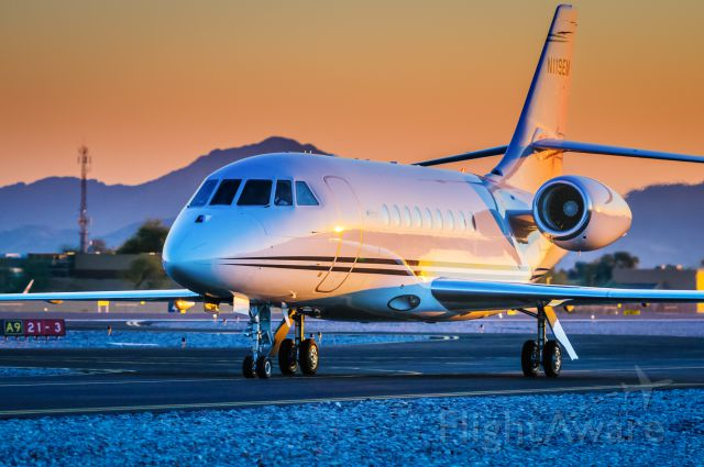 """Dassault Falcon 2000 (N119EM) - N119EM, a Falcon 2000 radiates beautifully in the late afternoon Arizona sunset. Belonging to Robson Communities here she is as she taxis back the hangar following a short flight from Santa Monica<br /><br />Please vote if you like my work! Thank you!<br /><br />©Bo Ryan Photography 