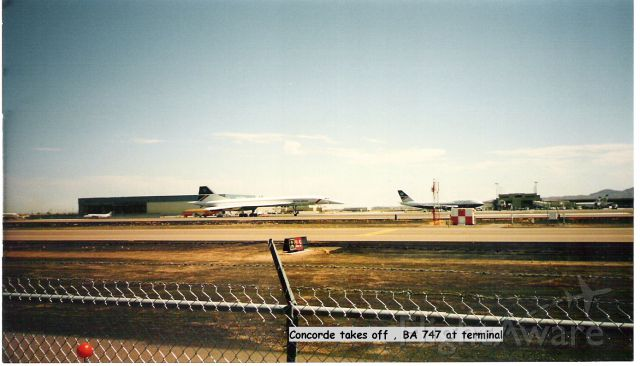 Aerospatiale Concorde — - British Airways Concorde in foreground at take off at Phoenix Sky Harbor with British Airways 747 at Gate in background