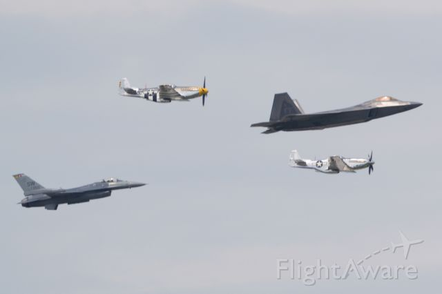 — — - USAF ACC Heritage Flight with two P-51s, an F-16 and F-22 in May 2019