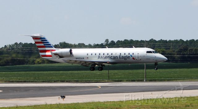 Canadair Regional Jet CRJ-200 (N405AW) - A Bombardier CRJ 200 about to land on Runway 36L at Jones Field, Huntsville International, AL on September 2, 2016. Shot with a Canon T5 in sports mode using a 75mm-300mm lens from over the top of the airport perimeter fence along taxiway beside the west Boeing road.