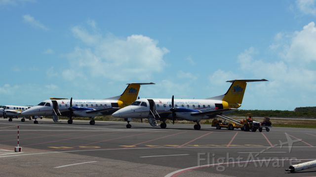 Embraer EMB-120 Brasilia (VQ-TBC) - 3 OF AIR TURKS AND CAICOS FLEET PARKED UP.