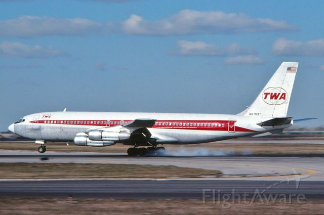 Boeing 707-100 (N6763T) - Twa 707 touching down at O'Hare back in 1976