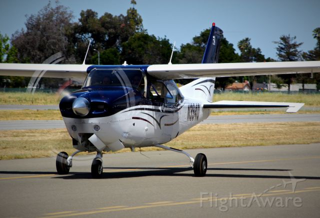 Cessna Centurion (N394Q) - Very sharp local Cessna T210 Turbo RG taxing in at Reid Hillview.