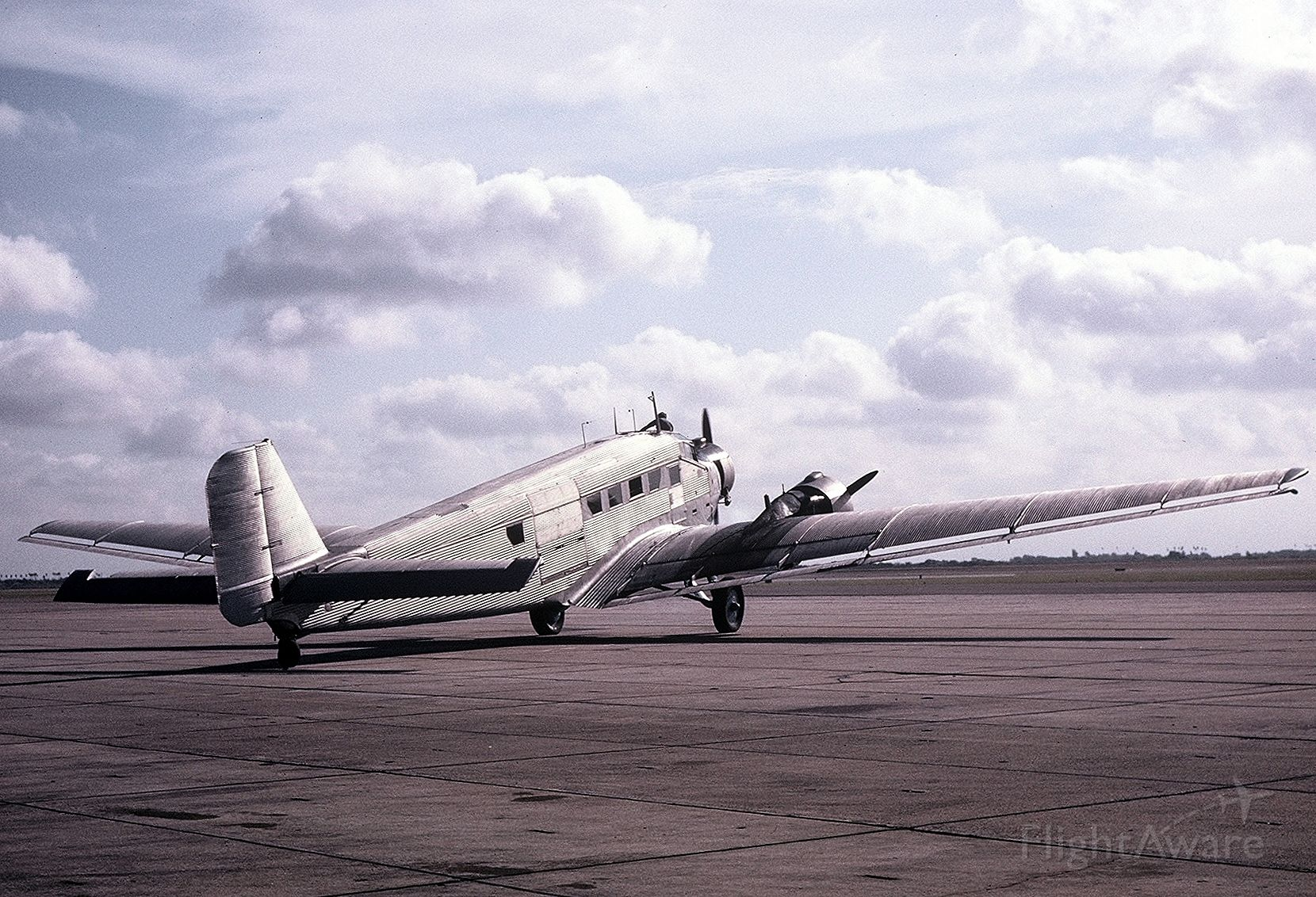 N99059 — - This JU-52 had just arrived from England and is seen on the ramp at the Commemorative Air Force.