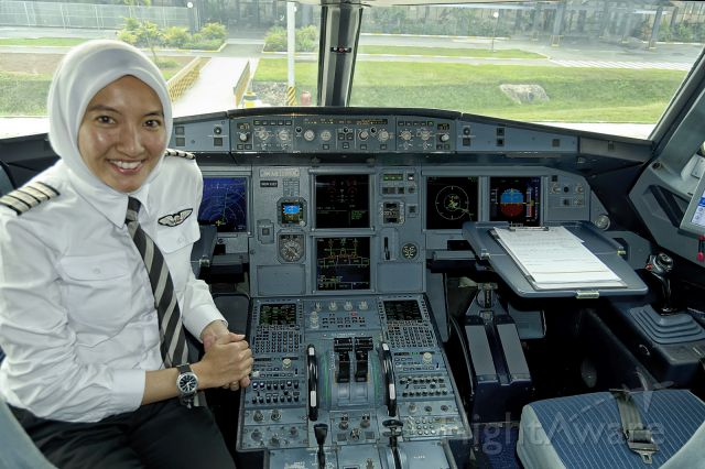 Airbus A320 (9M-AHE) - 21st Dec., 2014: Captain Nur Ishak poses for a shot after flying us in to Siem Reap from Kuala Lumpur (KLIA2).  According to her wrist watch, its 9:00am in KL ... which is 8am here in the home of Ankor Wat. (See a rel=nofollow href=http://www.airasia.com/travel3sixty/from-the-magazine/highlights/pilotsperspective/women-on-tophttp://www.airasia.com/travel3sixty/from-the-magazine/highlights/pilotsperspective/women-on-top/a)