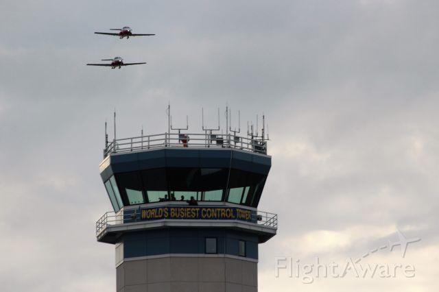 Canadair CL-41 Tutor — - Snowbird Solo Tudor Jets over the Tower at Oshkosh.