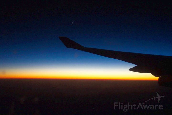 — — - Waxing moon over Atlantic on flight from Frankfurt to Buenos Aires.