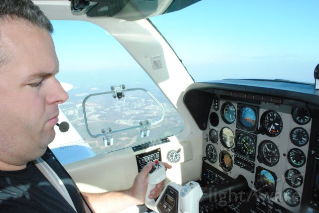 Beechcraft Bonanza (36) (N1116A) - Just after departure from KUZA.  Pilot TJ Maher.