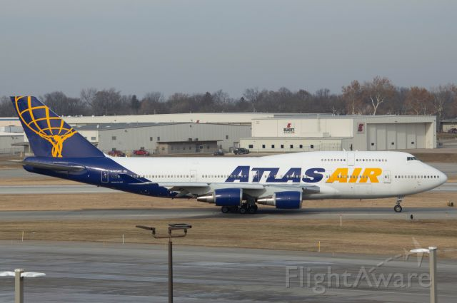 Boeing 747-400 (N465MC) - This beautiful Atlas Air 747-446 N465MC seen here at Des Moines having just picked up the Iowa State Cyclones to face Norte Dame in the Camping World Bowl in Orlando. Larger aircraft get use for bowl game charters as the entire team, support staff, cheerleaders, etc are allowed to go on the one group flight. The flight departed 1 hour & 3 minutes late as Atlas Air 8786 on Runway 23. For the first time I spotted at the North Parking Garage, and pretty much the entire DSM spotting squad was there as well!   Photo taken December 23, 2019 with Nikon D3200 at 100mm.