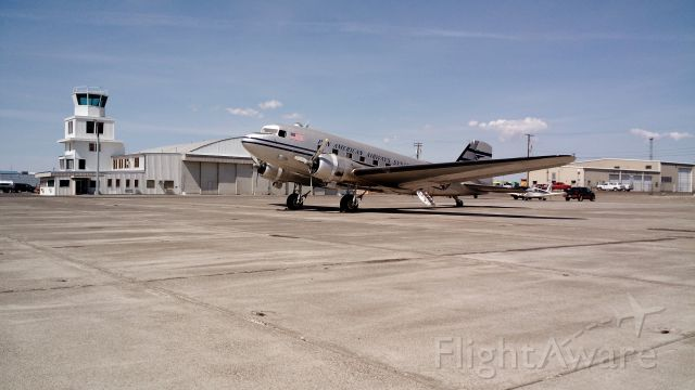 Douglas DC-3 (N877MG) - Ancient monster tail-dragging DC3 classing up the ramp in front of Bergstrom