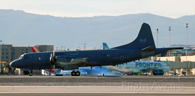 Lockheed P-3 Orion (14-0103) - A Royal Canadian Air Force / Aviation Royale Canadienne Lockheed CP-140 Aurora (RCAF Reg 140103) is on its noon-hour takeoff roll along KRNO's runway 16R yesterday (Nov 14, 2019).<br />The CP-140 is derived from the Lockheed P-3 Orion.