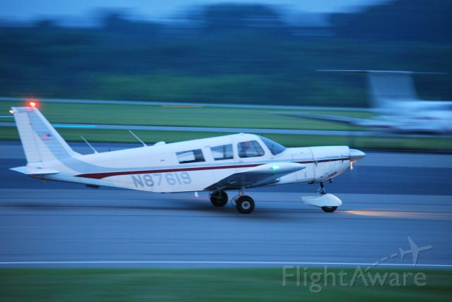Piper Saratoga/Lance (N87619) - BELLEFONTE INC Ram Air Freight taxiing in from runway 02 at KJQF - 6/15/09