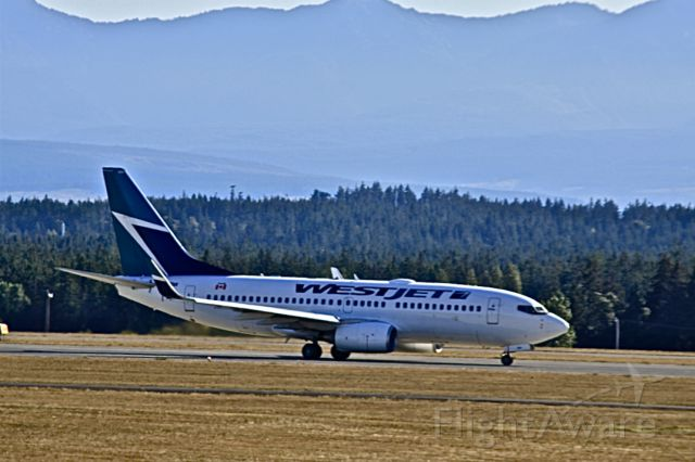 Boeing 737-700 (C-FWBW) - Take off at Comox
