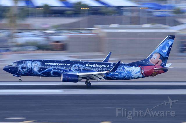 Boeing 737-800 (C-GWSZ) - Westjet 737-8CT C-GWSZ Magic Plane landing at Phoenix Sky Harbor International Airport on April 5, 2015.