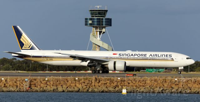 — — - SIA, B77W, slows down with reverse thrust on runway 16R.