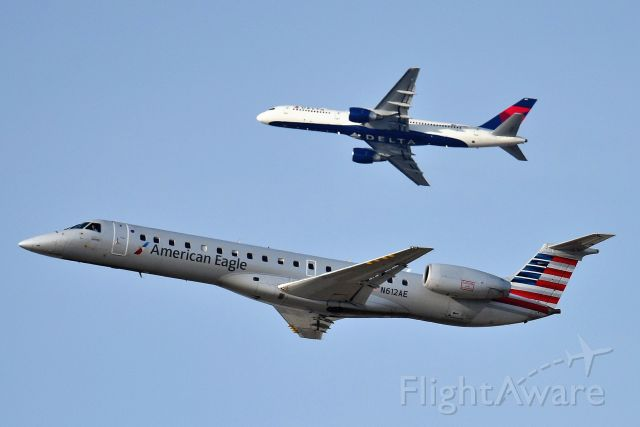 Embraer ERJ-145 (N612AE) - Eagle departing 28-R, with DL 757 departing off of 27-L in background. Shown on 03-19-19