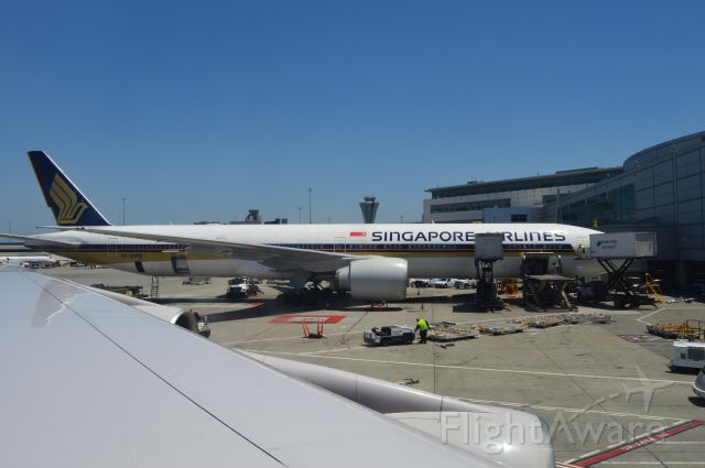 BOEING 777-300ER (9V-SWM) - Singapore Airlines 777 to Seoul. Taken on United 747