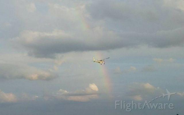 HELIO U-10 Super Courier (N461FM) - Helio Courier flying through rainbow at M17- Bolivar, MO