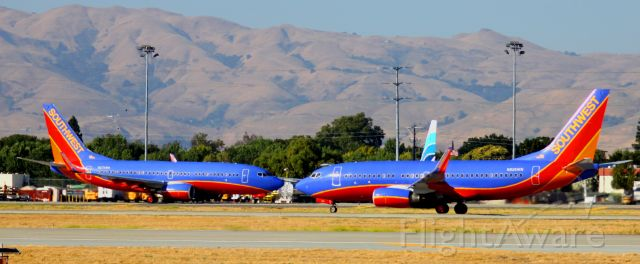 """Boeing 737-700 (N274WN) - """"FACE OFF"""" .. While N274WN (On Left) is taxiing to 30R for take off .. N926WN (Right) is on 30R during it"""