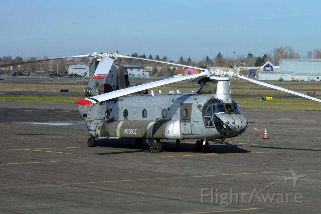 Boeing CH-47 Chinook (N160CZ) - Ex-Army CH-47D Chinook parked on the ramp in Salem (KSLE/SLE) after arriving from Medford (KMFR/MFR).
