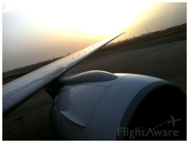 Boeing 777-200 (HZ-AKW) - Boarding the aircraft during the lovely sunset.