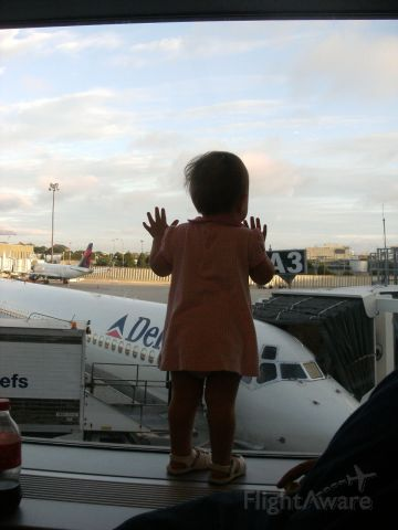 McDonnell Douglas MD-88 (N941DL) - My daughter checking out the plane that is going to take her to Disney World!    N941DL, flight 1315 BOS-MCO July 10, 2010
