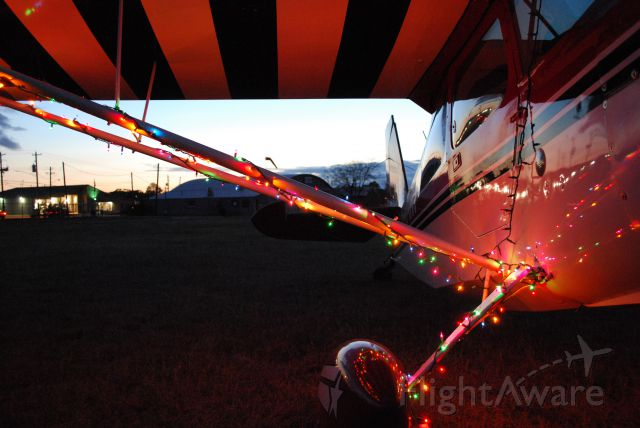 CHAMPION Decathlon (N594AM) - This is my favorite. A classic airplane with a classic hangar in the background- all wrapped in Christmas lights!