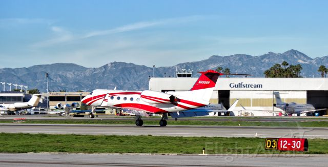 Gulfstream Aerospace Gulfstream IV (N89888) - A beautiful red and white Gulfstream G-IV (N89888) touching down between the Gulfstream facility signs at KLGB