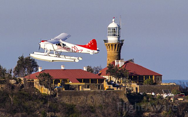De Havilland Canada DHC-2 Mk1 Beaver (VH-NOO) - Taken from west head NSW Australia. The plane is in front of the Palm Beach Lighthouse.